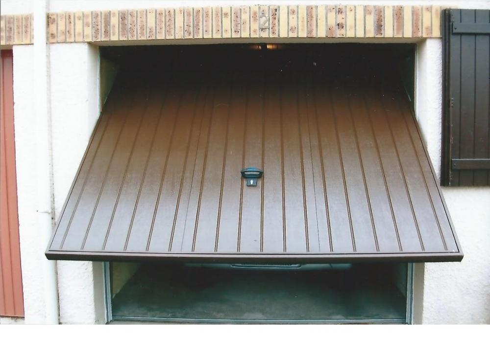Porte de garage sur mesure installation cergy vaur al 95 - Installation porte de garage basculante ...