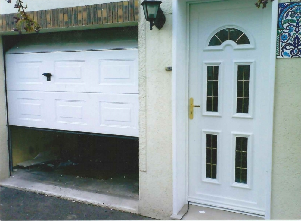 Porte de garage pose remplacement cergy vaur al 95 60 for Porte garage 60